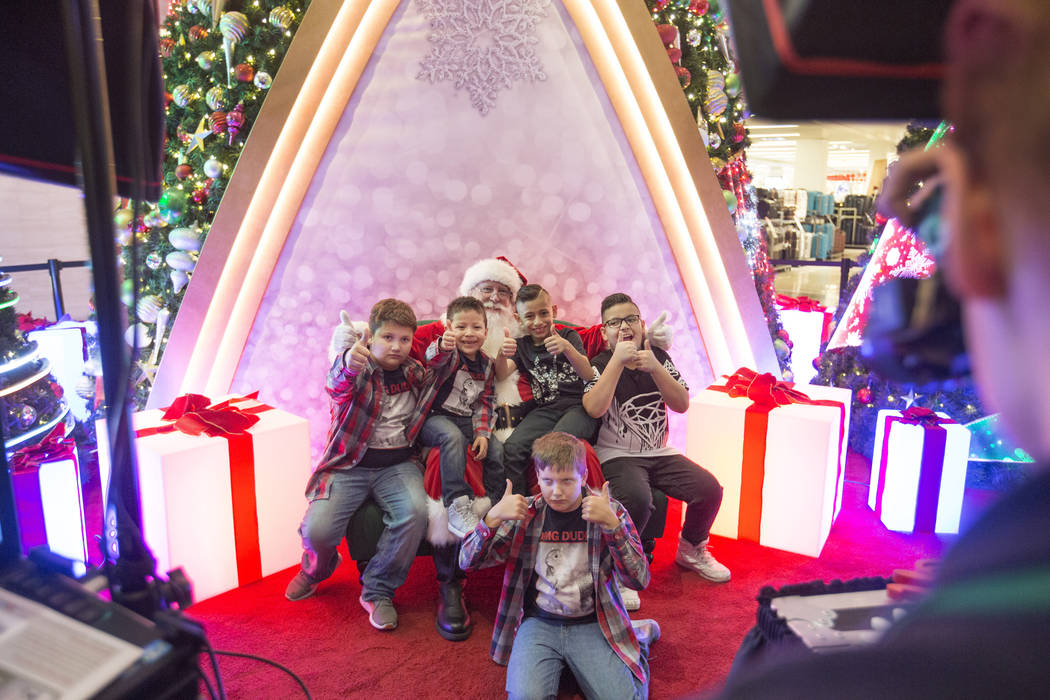 The King family and their cousins take a photo with Santa as a family tradition, at the Fashion Show mall in Las Vegas, Wednesday, Dec. 6, 2017. Elizabeth Brumley Las Vegas Review-Journal  @EliPag ...