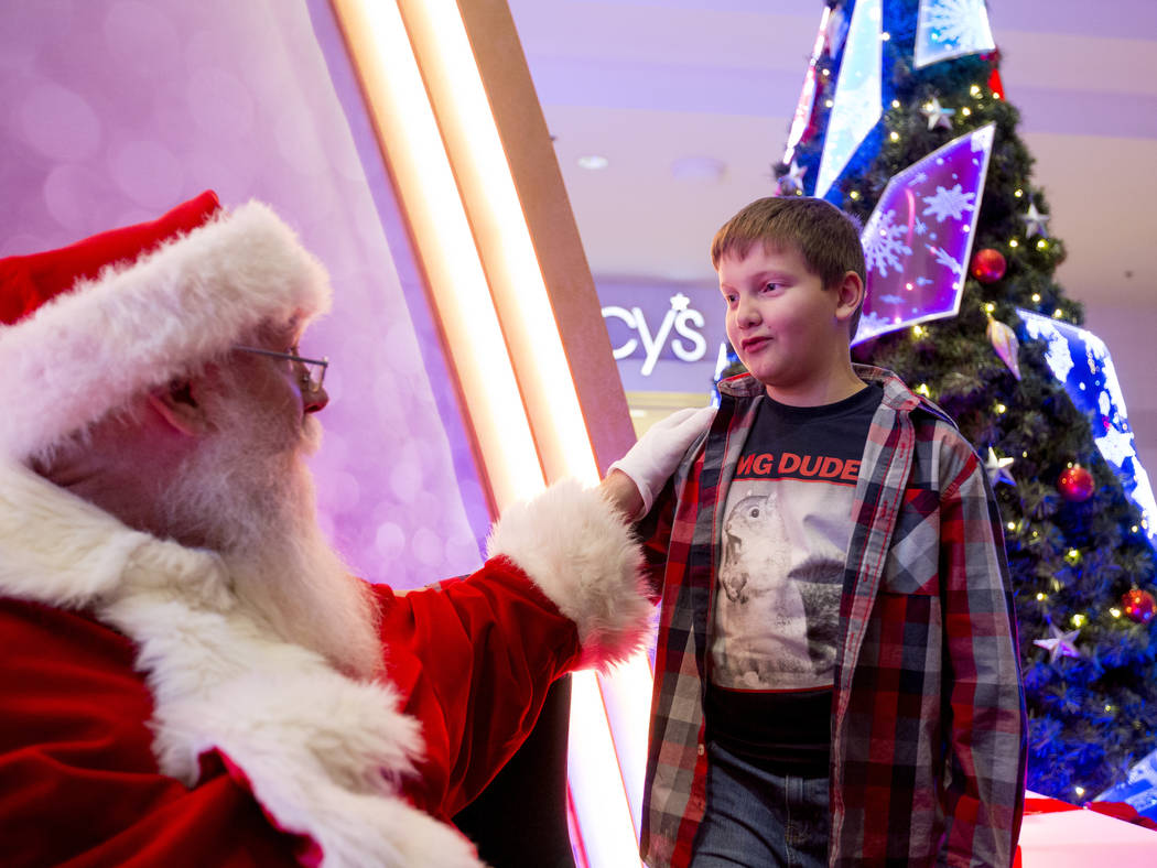 Enoch King, 9, shares his wish list with Santa at the Fashion Show mall in Las Vegas, Wednesday, Dec. 6, 2017. Elizabeth Brumley Las Vegas Review-Journal  @EliPagePhoto