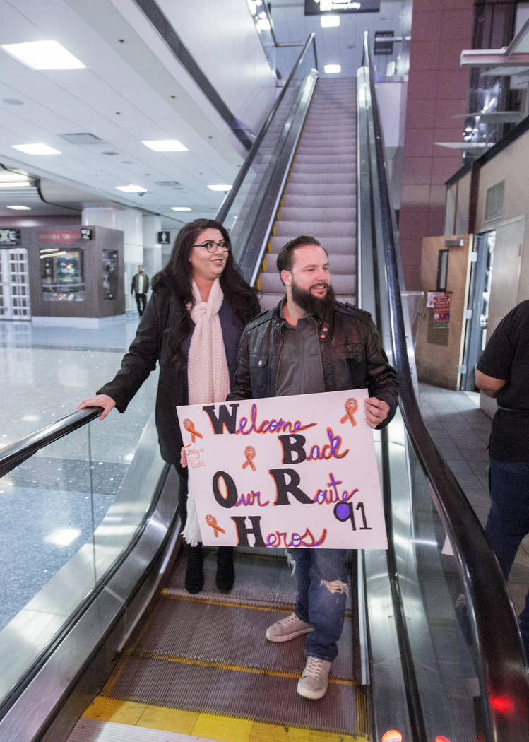 William King, left, Kimberly Calderon anxiously wait to meet their heroes at the Saturday, Dec. 9, 2017, at McCarran International Airport in Las Vegas. Jospeh and Paol Nolan helped bring King and ...