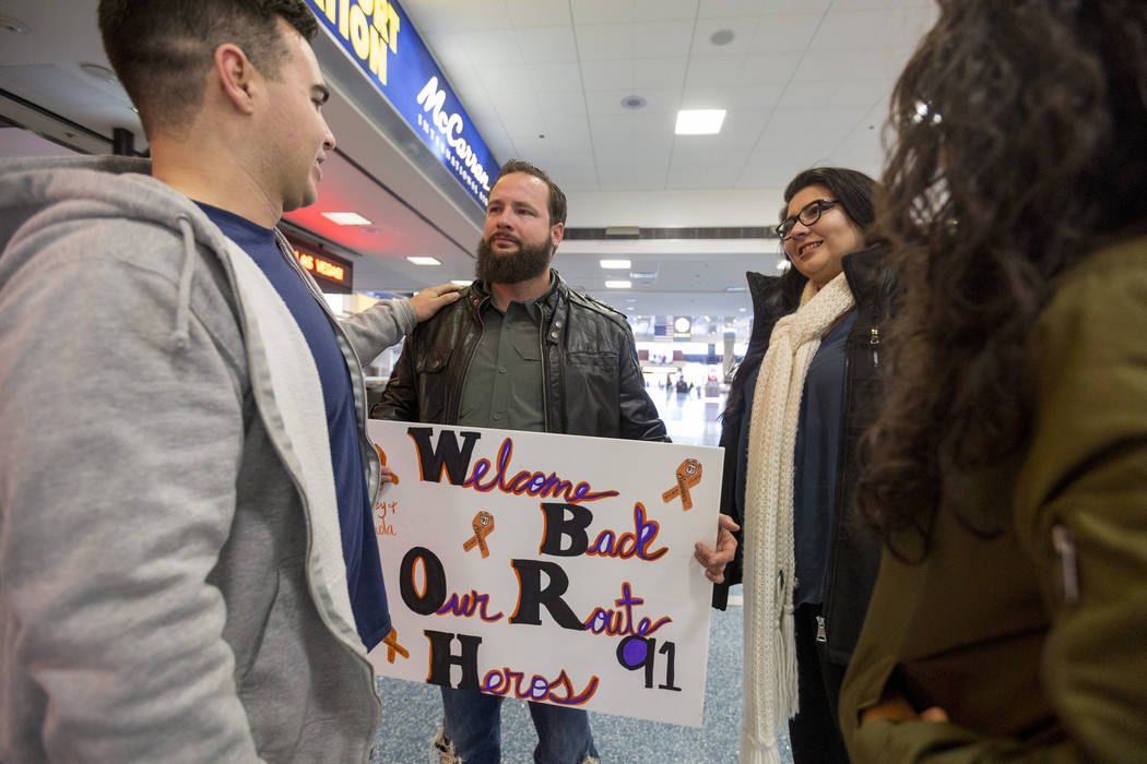 Joseph Nolan, from left, William King, Kimberly Calderon and Paol Nolan meet at Saturday, Dec. 9, 2017, at McCarran International Airport in Las Vegas. It was the first time the couples has met si ...