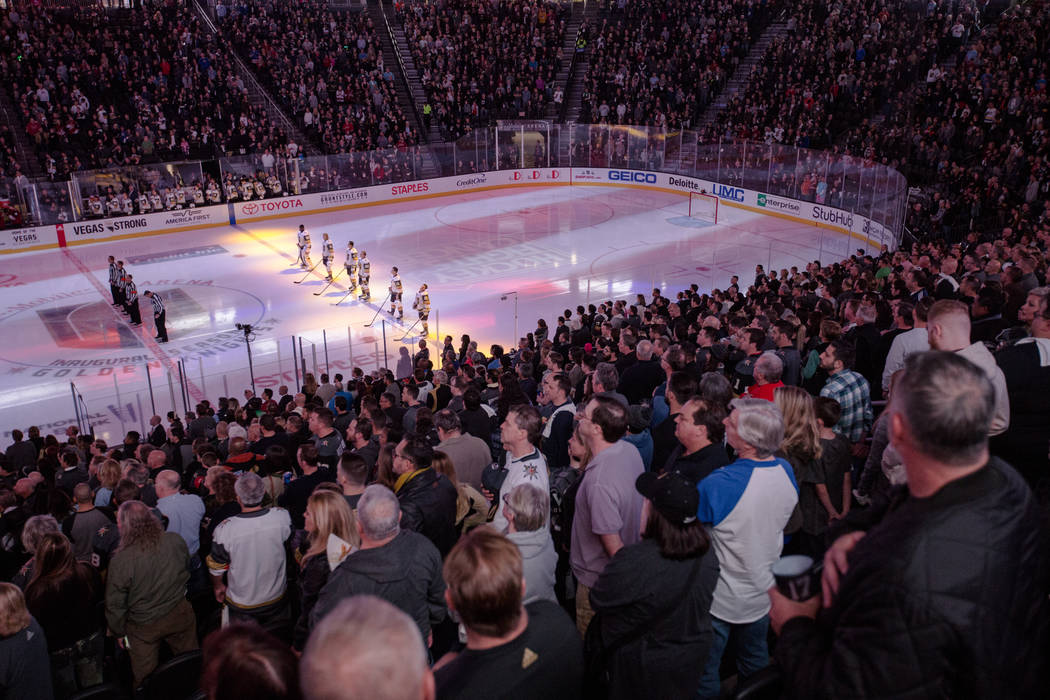Vegas Golden Knights stand on the rink during the pledge of allegiance before the first period of a hockey game against the Arizona Coyotes at T-Mobile Arena in Las Vegas, Sunday, Dec. 3, 2017. Jo ...