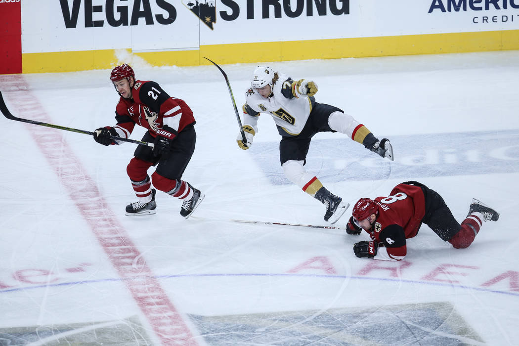 Arizona Coyotes center Derek Stepan (21), left, Vegas Golden Knights center William Karlsson (71), center, and Arizona Coyotes right wing Tobias Rieder (8), right, chase after the puck during the  ...