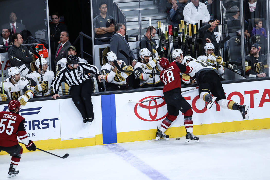 Arizona Coyotes left wing Jordan Martinook (48), left, knocks Vegas Golden Knights left wing James Neal (18), right, into the side of the rink during the first period of a hockey game at T-Mobile  ...