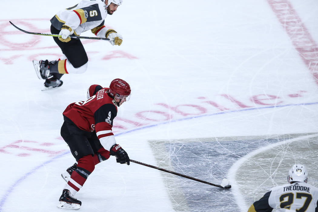Arizona Coyotes center Clayton Keller (9) moves the puck up the rink during the first period of a hockey game against the Vegas Golden Knights at T-Mobile Arena in Las Vegas, Sunday, Dec. 3, 2017. ...