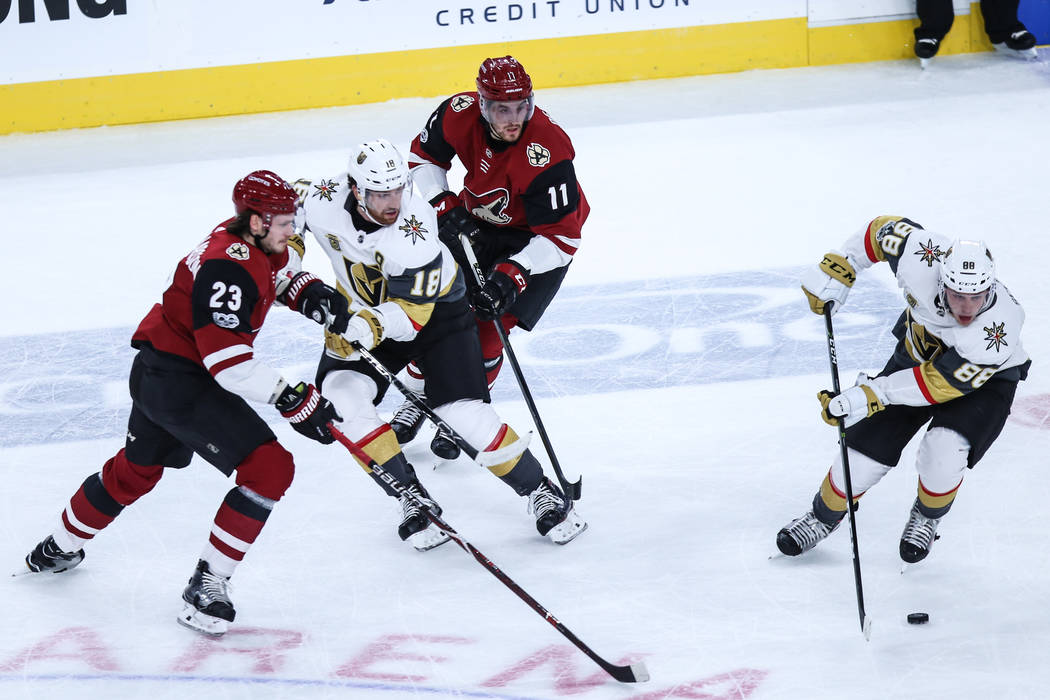 Arizona Coyotes defenseman Oliver Ekman-Larsson (23), left, Vegas Golden Knights left wing James Neal (18), second from left, Arizona Coyotes left wing Brendan Perlini (11), second from right, and ...