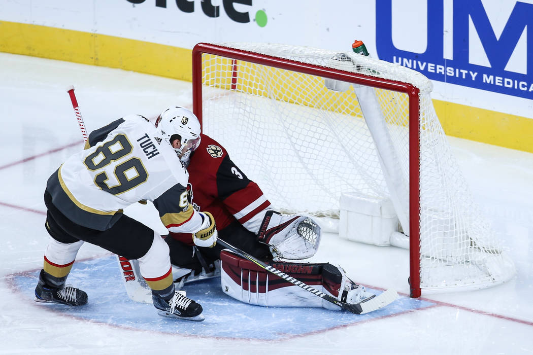 Vegas Golden Knights Alex Such (89), left, scores on Arizona Coyotes goalie Scott Wedgewood (31), right, during the second period of a hockey game at T-Mobile Arena in Las Vegas, Sunday, Dec. 3, 2 ...