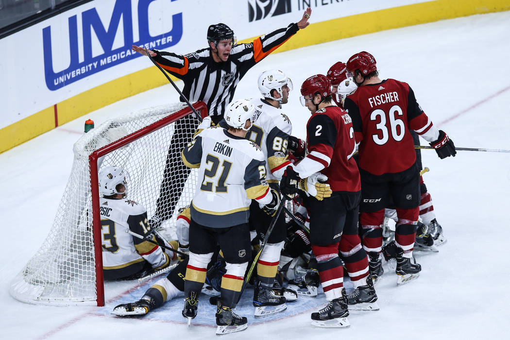 Vegas Golden Knights and Arizona Coyotes scramble over the puck during the second period of a hockey game at T-Mobile Arena in Las Vegas, Sunday, Dec. 3, 2017. Vegas Golden Knights won 3-2 in over ...