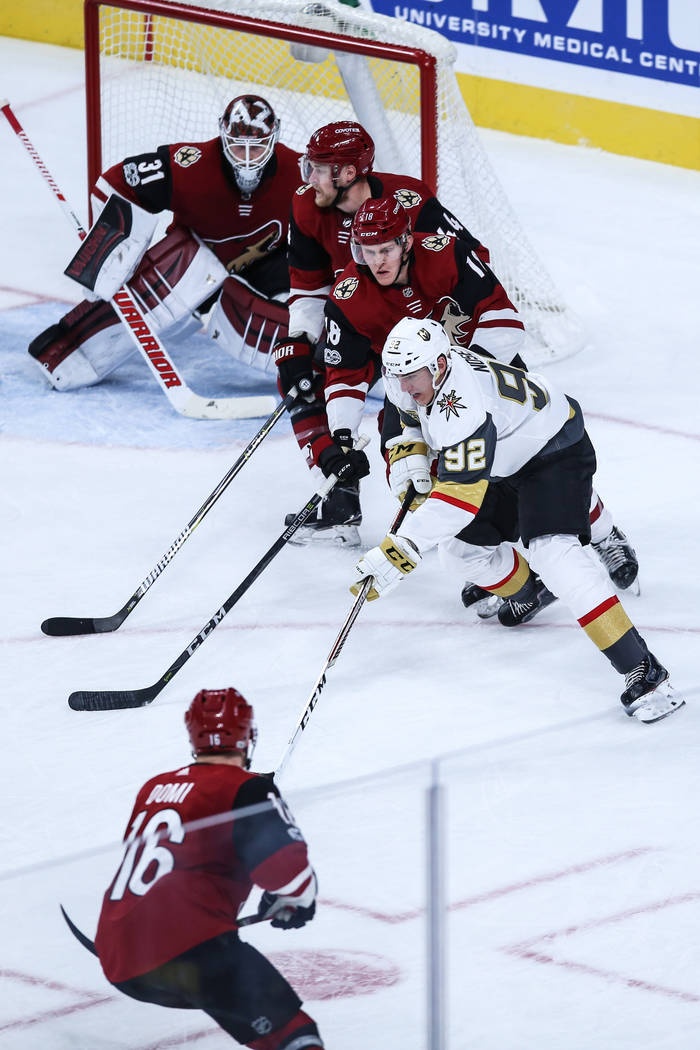 Vegas Golden Knights left wing Tomas Nosek (92), right, chases after the puck as he is followed by the Arizona Coyotes during the second period of a hockey game at T-Mobile Arena in Las Vegas, Sun ...