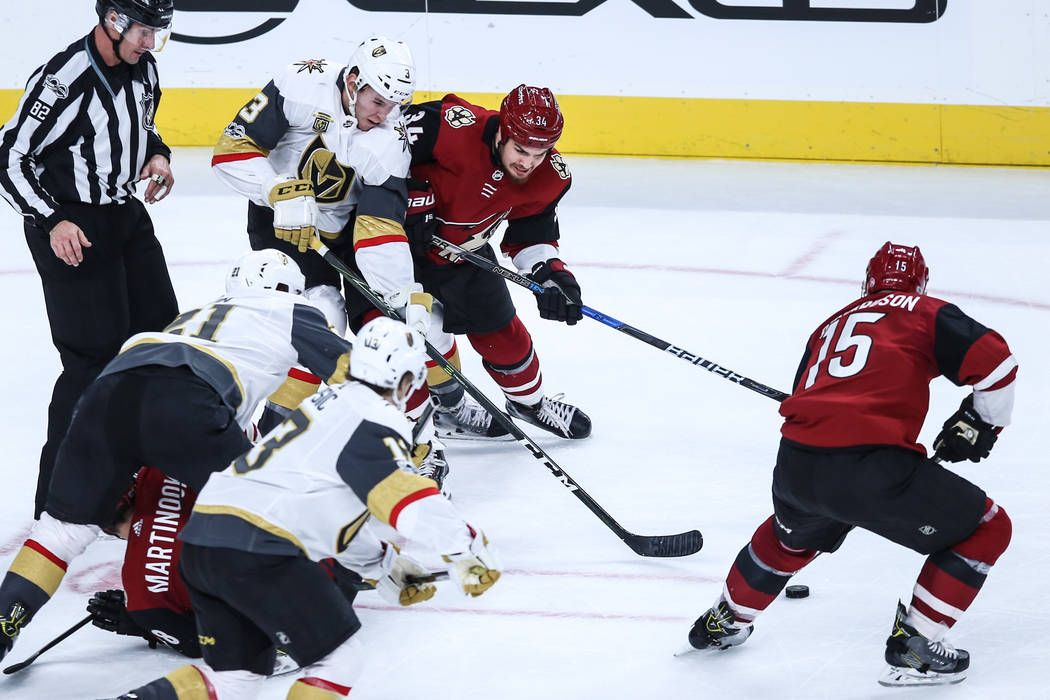 Vegas Golden Knights defenseman Brayden McNabb (3), top left, and Arizona Coyotes center Zac Rinaldo (34), top right, chase after the puck during the second period of a hockey game at T-Mobile Are ...