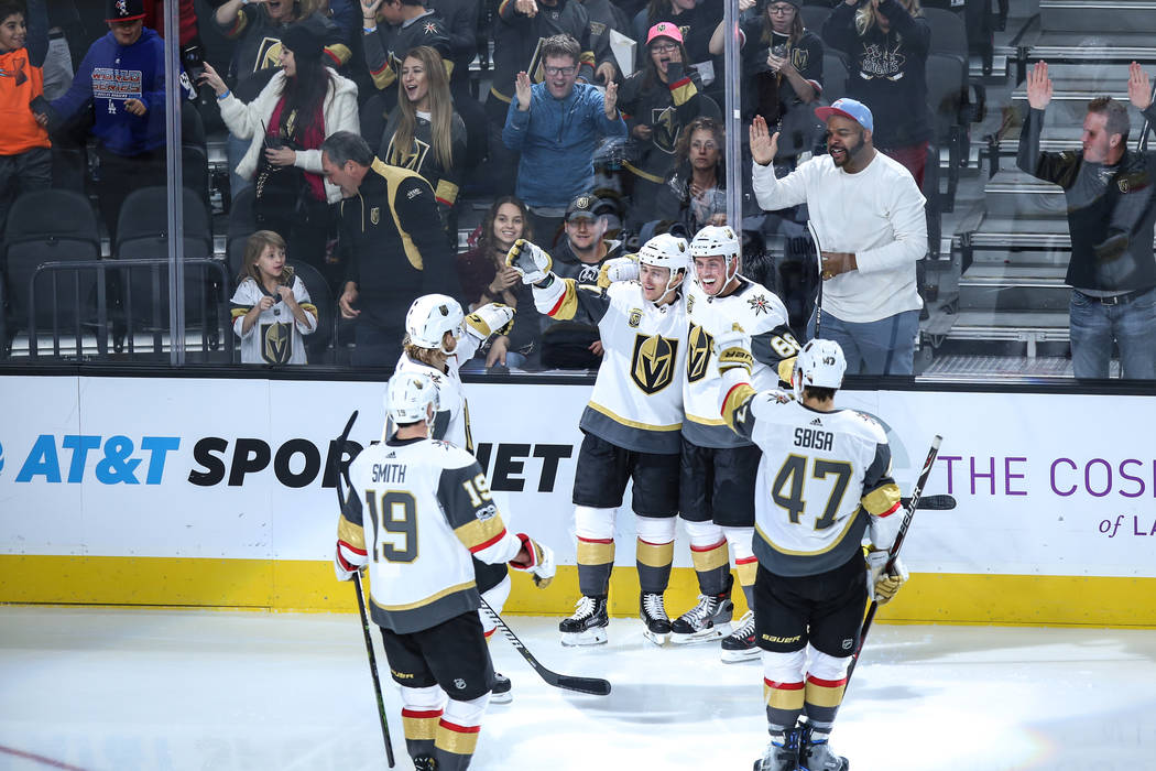 Vegas Golden Knights center Jonathan Marchessault (81), left, celebrates with defenseman Nate Schmidt (88), right, after scoring against the Arizona Coyotes during the third period of a hockey gam ...
