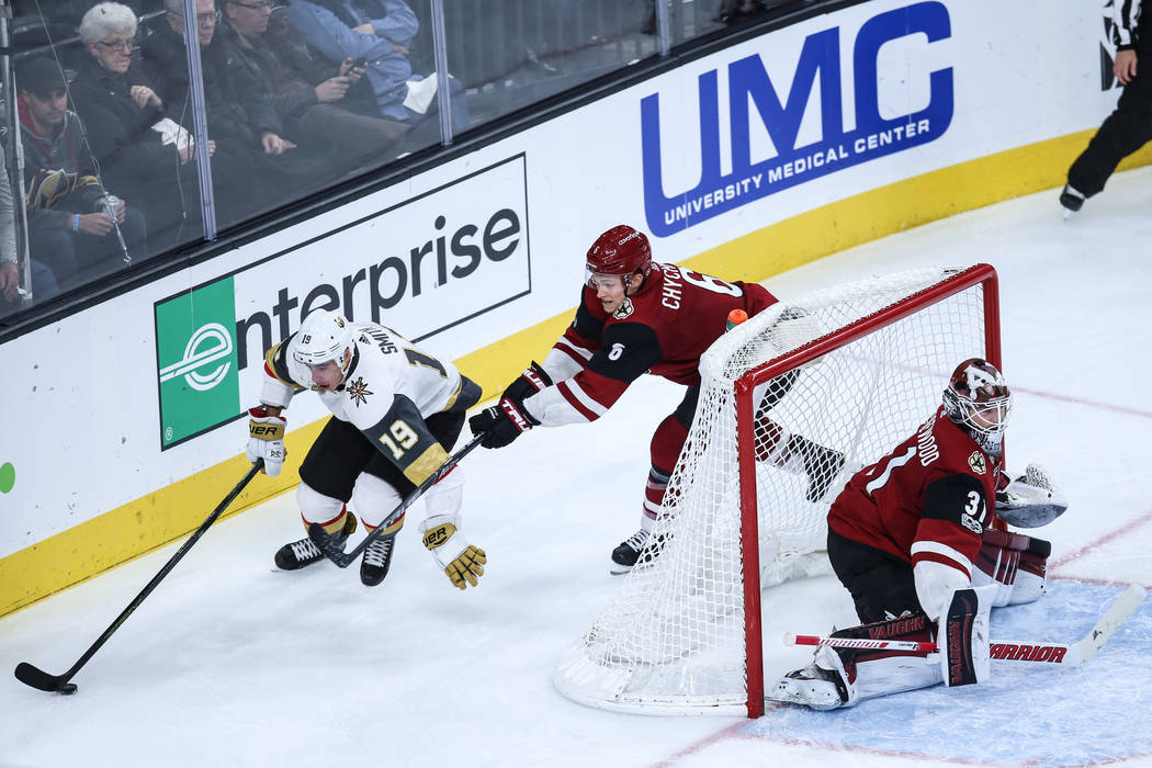 Vegas Golden Knights right wing Reilly Smith (19), left, and Arizona Coyotes defenseman Jakob Chychrun (6), center, chase after the puck during the third period of a hockey game at T-Mobile Arena  ...