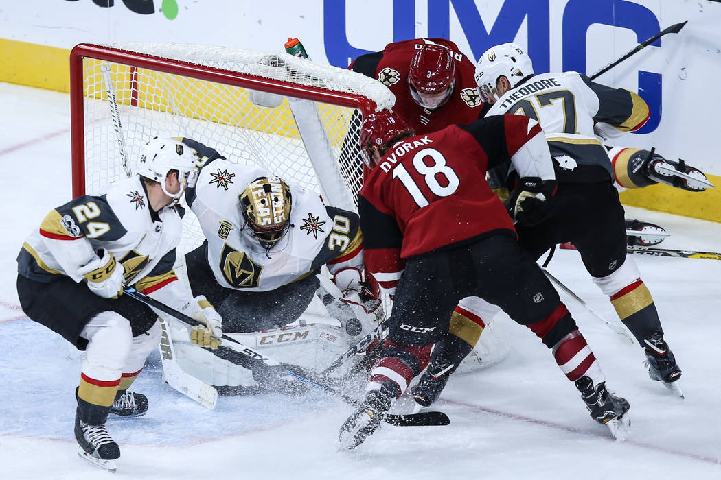 Vegas Golden Knights goalie Malcolm Subban (30), second from left, guards the goal as the Arizona Coyotes attempt a shot during the third period of a hockey game at T-Mobile Arena in Las Vegas, Su ...