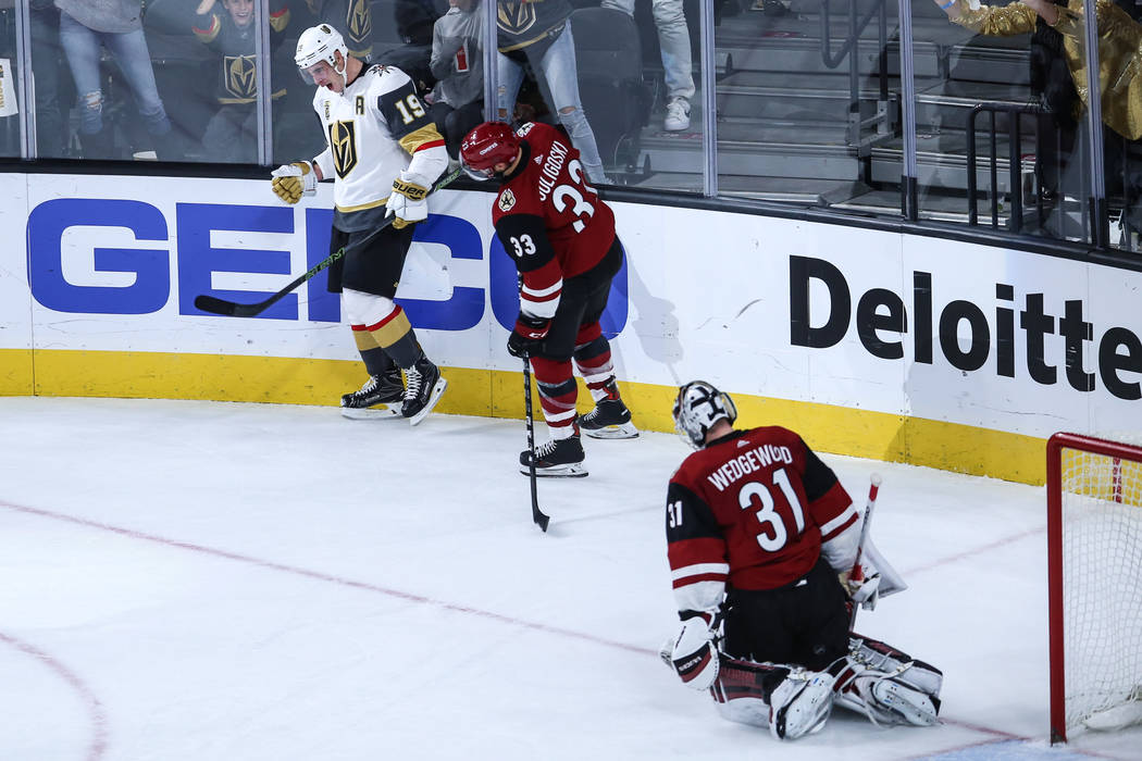 Vegas Golden Knights right wing Reilly Smith (19), left, celebrates after scoring the game-winning goal against the Arizona Coyotes during overtime of a hockey game at T-Mobile Arena in Las Vegas, ...