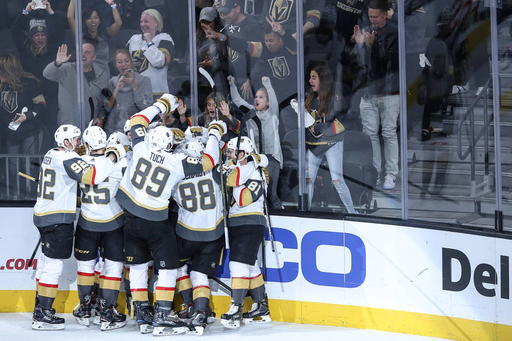 Vegas Golden Knights celebrate after defeating the Arizona Coyotes 3-2 in overtime of a hockey game at T-Mobile Arena in Las Vegas, Sunday, Dec. 3, 2017. Joel Angel Juarez Las Vegas Review-Journal ...