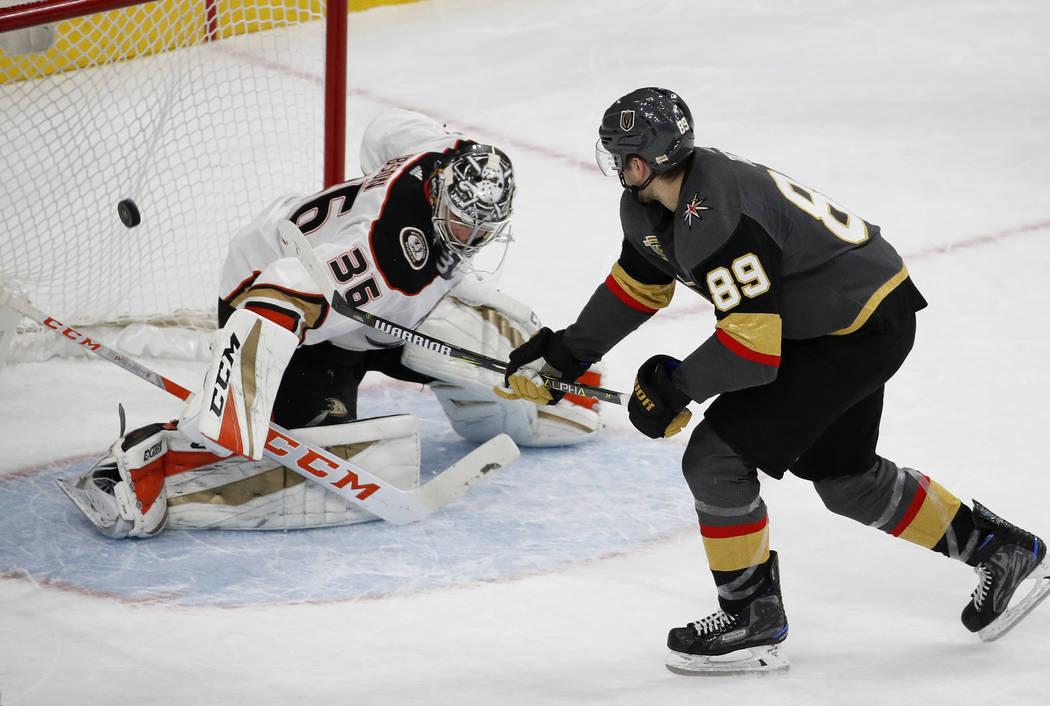 Vegas Golden Knights right wing Alex Tuch scores the only goal of the shootout, against Anaheim Ducks goalie John Gibson in an NHL hockey game Tuesday, Dec. 5, 2017, in Las Vegas. The Knights won  ...
