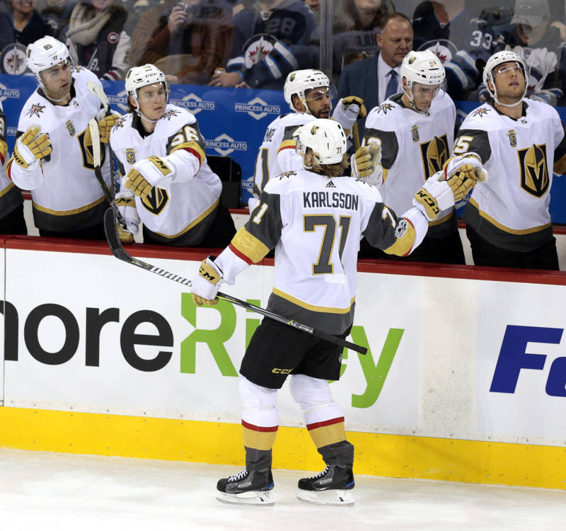 Dec 1, 2017; Winnipeg, Manitoba, CAN;  Vegas Golden Knights teammates celebrate the first period goal byVegas Golden Knights center William Karlsson (71) at Bell MTS Place. Mandatory Credit: James ...