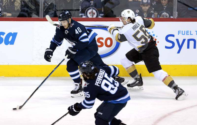 Dec 1, 2017; Winnipeg, Manitoba, CAN;  Vegas Golden Knights left wing Erik Haula (56) chases down Winnipeg Jets right wing Joel Armia (40) in first period action at Bell MTS Place. Mandatory Credi ...