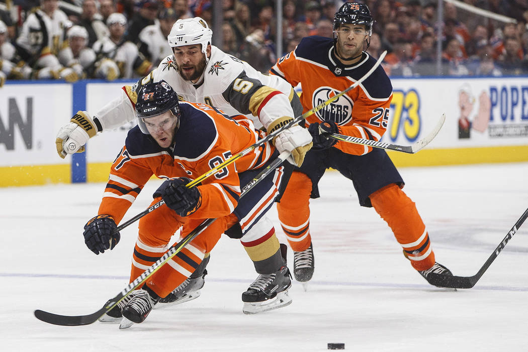 Vegas Golden Knights' Deryk Engelland (5) chases Edmonton Oilers' Connor McDavid (97) during the second period of an NHL hockey game Tuesday, Nov. 14, 2017, in Edmonton, Alberta. (Jason Franson/Th ...