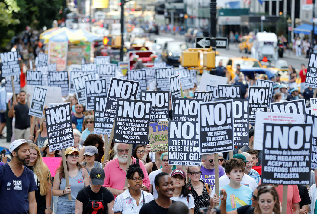 "Protesters march against white nationalism in New York City, the day after the attack on counter-protesters at the ""Unite the Right"" rally organized by white nationalists in Char ..."