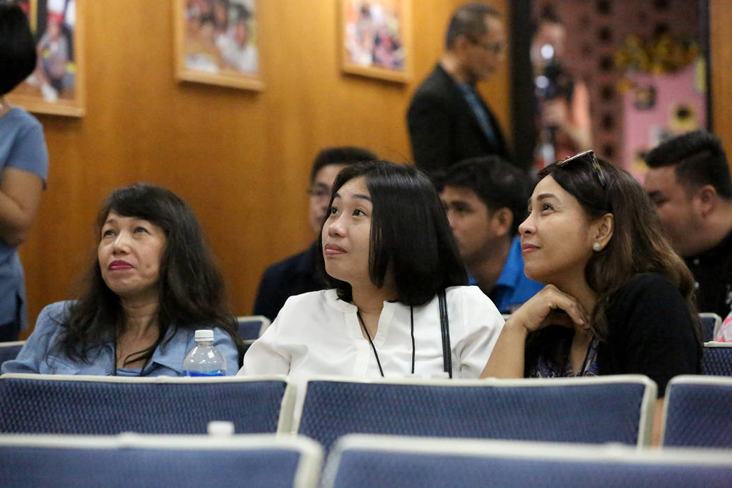 Reniella P. Perez, from left, Amy Irene Salayog and Gina Mejia await orientation on Tuesday, July 11, 2017, with over 70 fellow teachers the Clark County School District brought in from the Philip ...