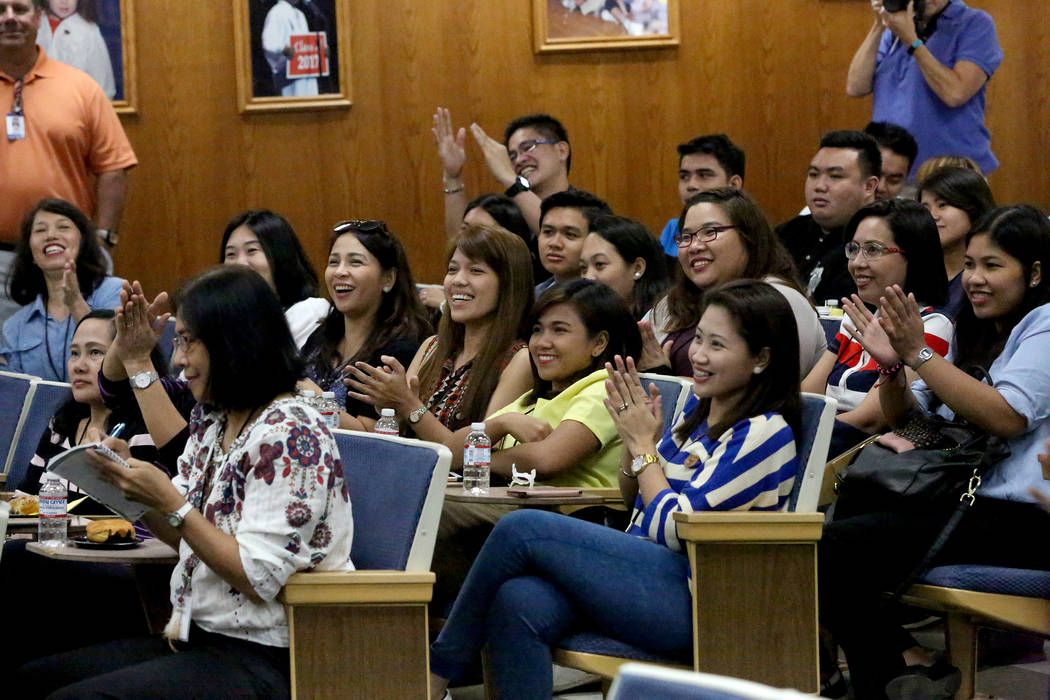 Teachers from the Philippines applaud after being welcomed to the Clark County School District, during orientation of over 70 Filipino applicants brought in to fill a shortage of special education ...