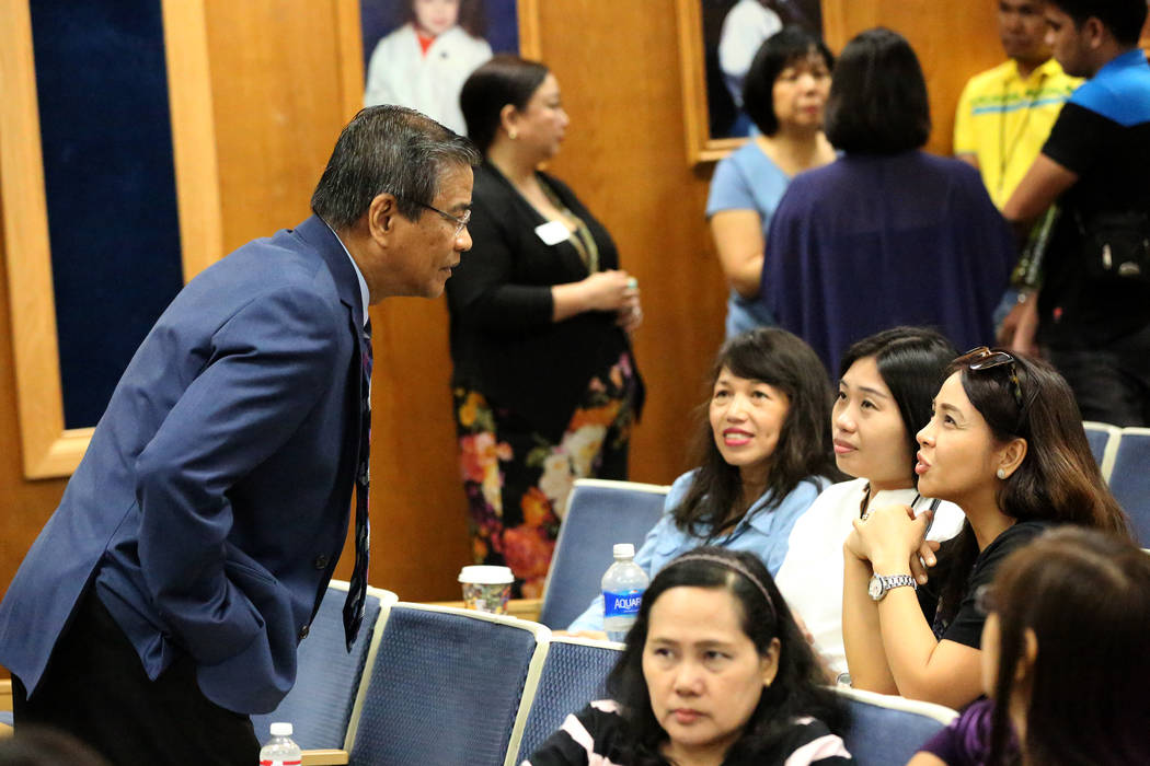 Bernie Benito, from left, chairman of the National Federation of Filipino American Associations, speaks with several of the 82 teachers on Tuesday, July 11, 2017, that the Clark County School Dist ...