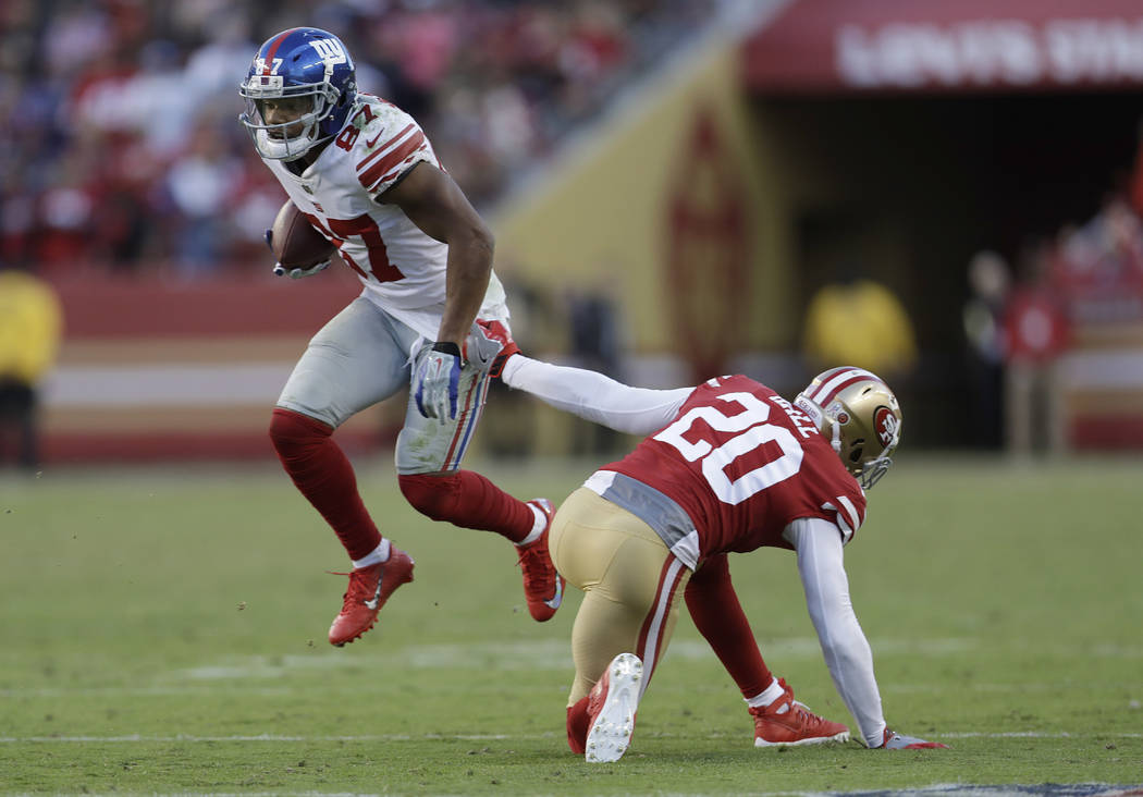 New York Giants wide receiver Sterling Shepard (87) runs past San Francisco 49ers defensive back Leon Hall (20) during the second half of an NFL football game in Santa Clara, Calif., Sunday, Nov.  ...