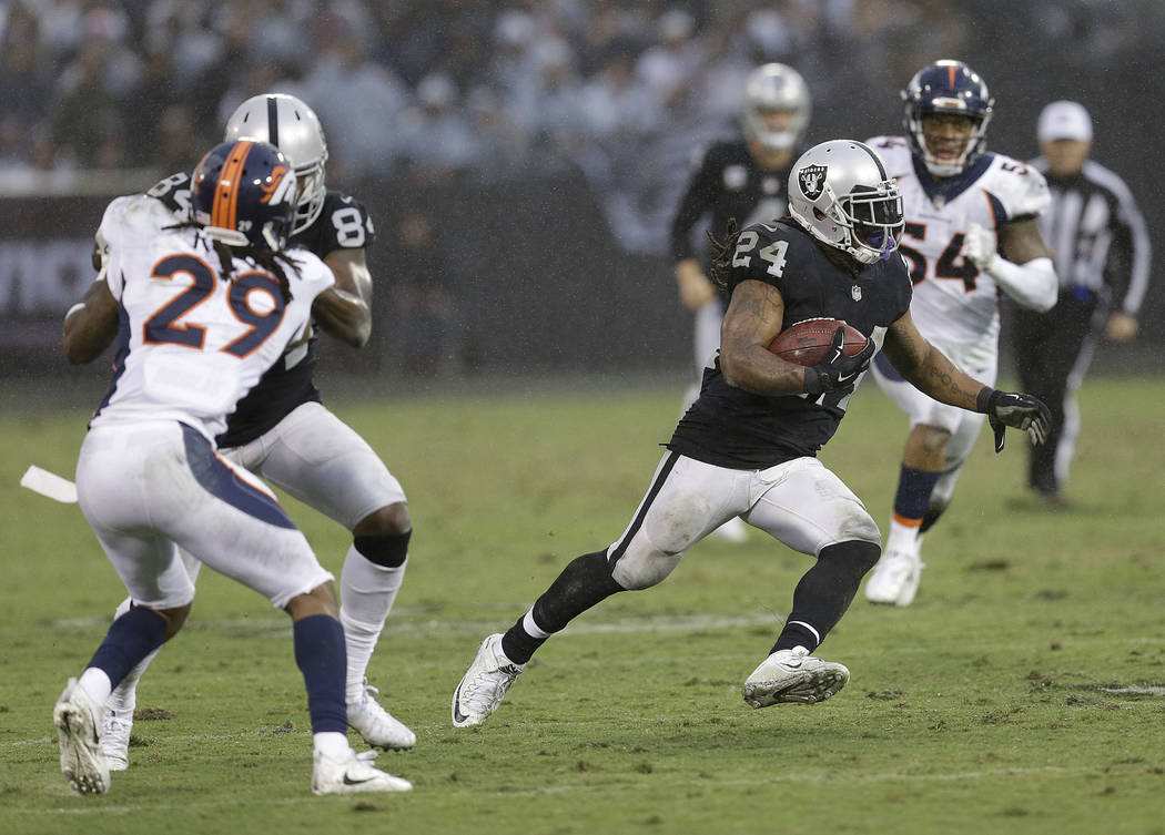Oakland Raiders running back Marshawn Lynch (24) runs against the Denver Broncos during the second half of an NFL football game in Oakland, Calif., Sunday, Nov. 26, 2017. (AP Photo/Ben Margot)