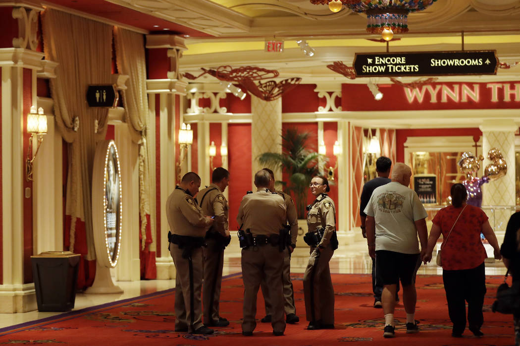 Police officers talk in the lobby of the Wynn hotel on Wednesday, Oct. 4, 2017, in Las Vegas. A gunman opened fire on an outdoor music concert on Sunday killing dozens and injuring hundreds. Secur ...