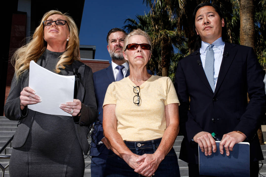 Attorney Christian M. Morris, left, attorney Brian D. Nettles, second from left, Cheryl Sheppard, mother of Rachel Sheppard, second from right, lead attorney James Lee, right, gather in front of t ...