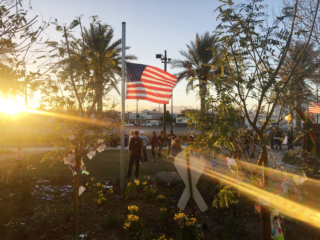 Individuals pay respects to the Route 91 Harvest festival victims at the Las Vegas Community Healing Garden in Las Vegas, Sunday, Nov. 5, 2017. Elizabeth Brumley Las Vegas Review-Journal @EliPagePhoto