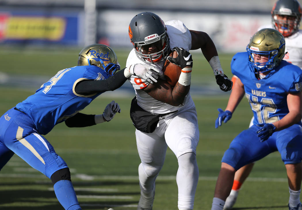 Bishop Gorman's Brevin Jordan runs for a touchdown against Reed in the first half of the NIAA 4A state championship football game in Reno, Nev., on Saturday, Dec. 2, 2017. Cathleen Allison/ ...