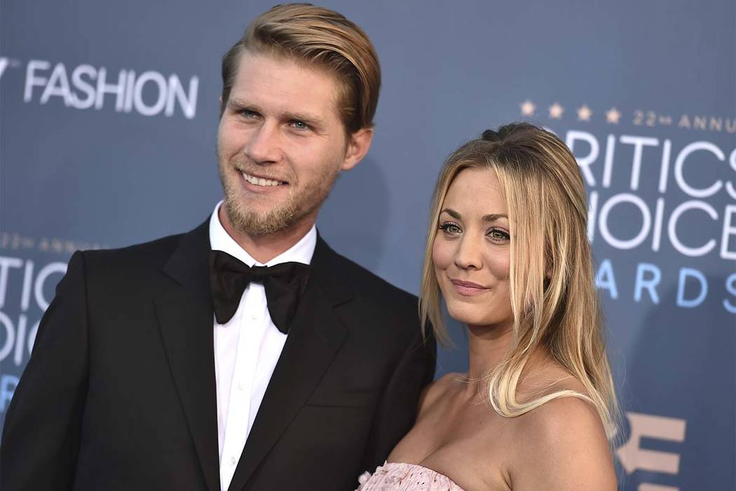 In this  Dec. 11, 2016, file photo, Kaley Cuoco and Karl Cook arrive at the 22nd annual Critics' Choice Awards at the Barker Hangar in Santa Monica, Calif. The couple announced their engagement on ...