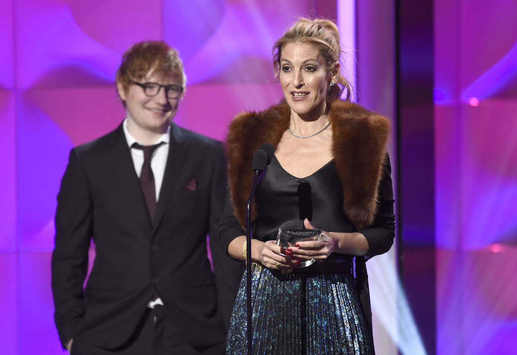 Julie Greenwald accepts the executive of the year award at the Billboard Women in Music event at the Ray Dolby Ballroom on Thursday, Nov. 30, 2017, in Los Angeles. Looking on at left is presenter  ...