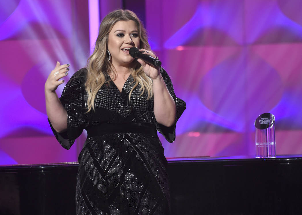 Kelly Clarkson accepts the powerhouse award at the Billboard Women in Music event at the Ray Dolby Ballroom on Thursday, Nov. 30, 2017, in Los Angeles. (Chris Pizzello/Invision/AP)
