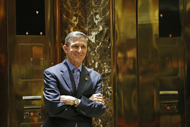 Then National Security Adviser-designate Michael T. Flynn waits for an elevator in the lobby at Trump Tower in New York, Dec. 12, 2016. (Kathy Willens/AP, File)
