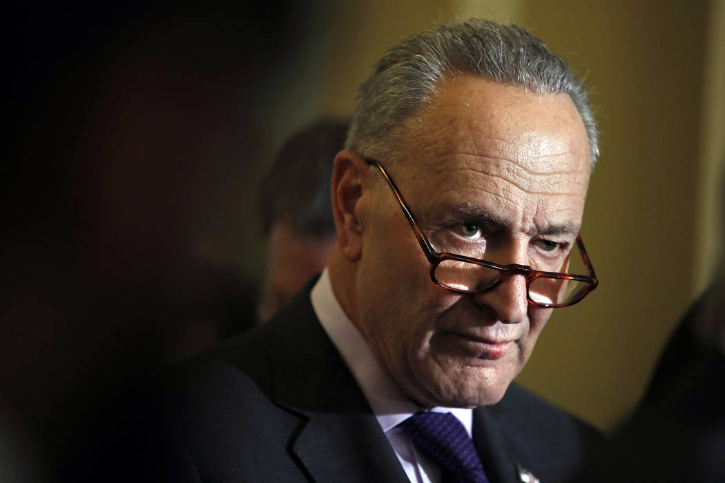 Senate Minority Leader Sen. Chuck Schumer of N.Y., listens during a news conference with Senate Democratic leadership, Tuesday, Nov. 28, 2017, on Capitol Hill in Washington. (AP Photo/Jacquelyn Ma ...