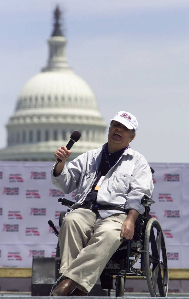 Former White House press secretary Jim Brady addresses participants of the Million Mom March on the Mall in Washington Sunday, May 14, 2000. Brady was shot during President Reagan's assassination  ...