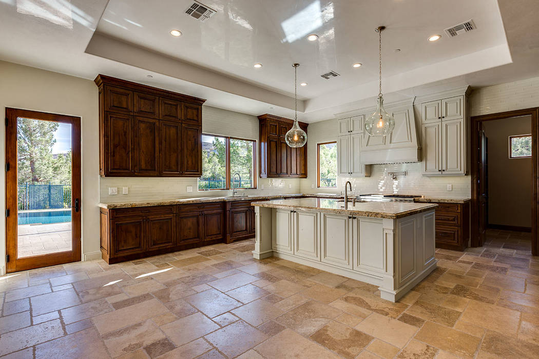 This home in Southern Highlands offers a kitchen that opens to the pool. (Shapiro & Sher Group)