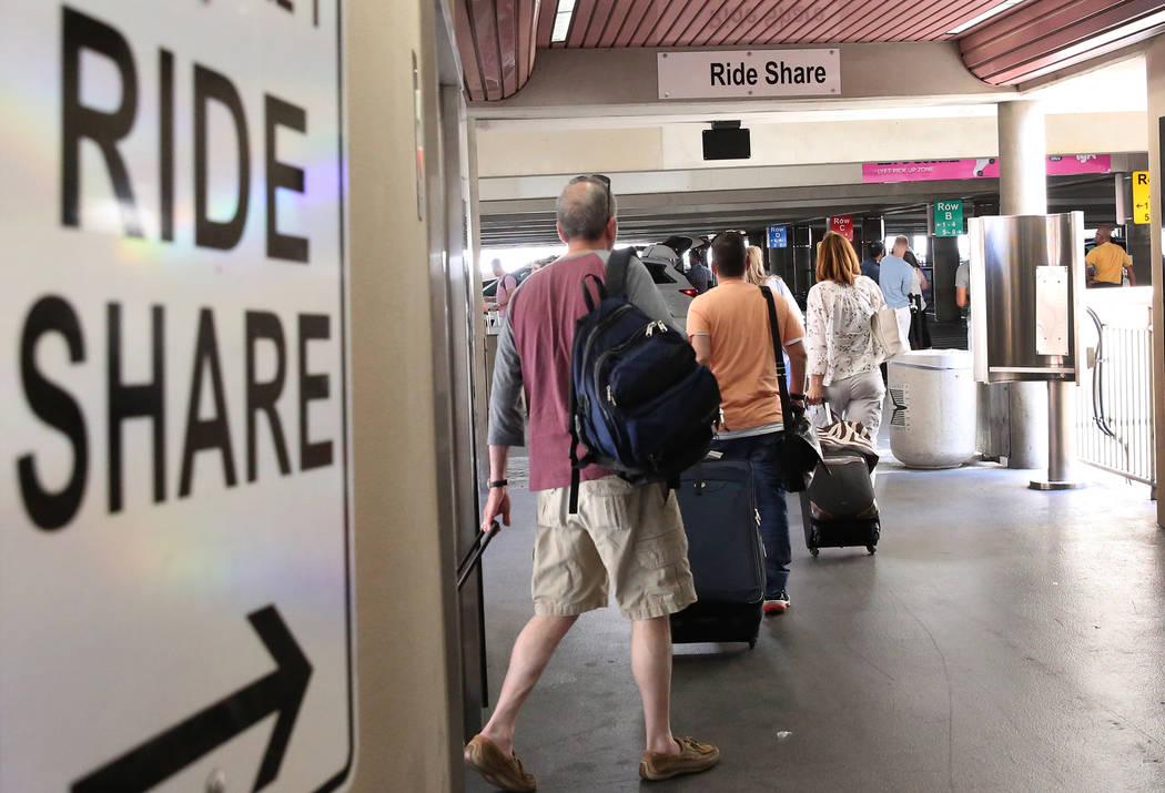 Riders arrive at Ride-hailing companies' Uber and Lyft pick up area at McCarran International Airport at Terminal 1 on Thursday, June 1, 2017, in Las Vegas. Bizuayehu Tesfaye Las Vegas Review-Jour ...