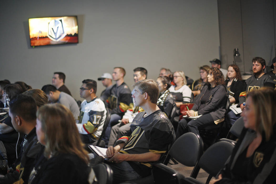 Avid hockey fans listen during a session of Vegas Golden Knights University, a five-session program to give fans an in-depth understanding of the ins and outs of hockey at the T-Mobile Arena in La ...