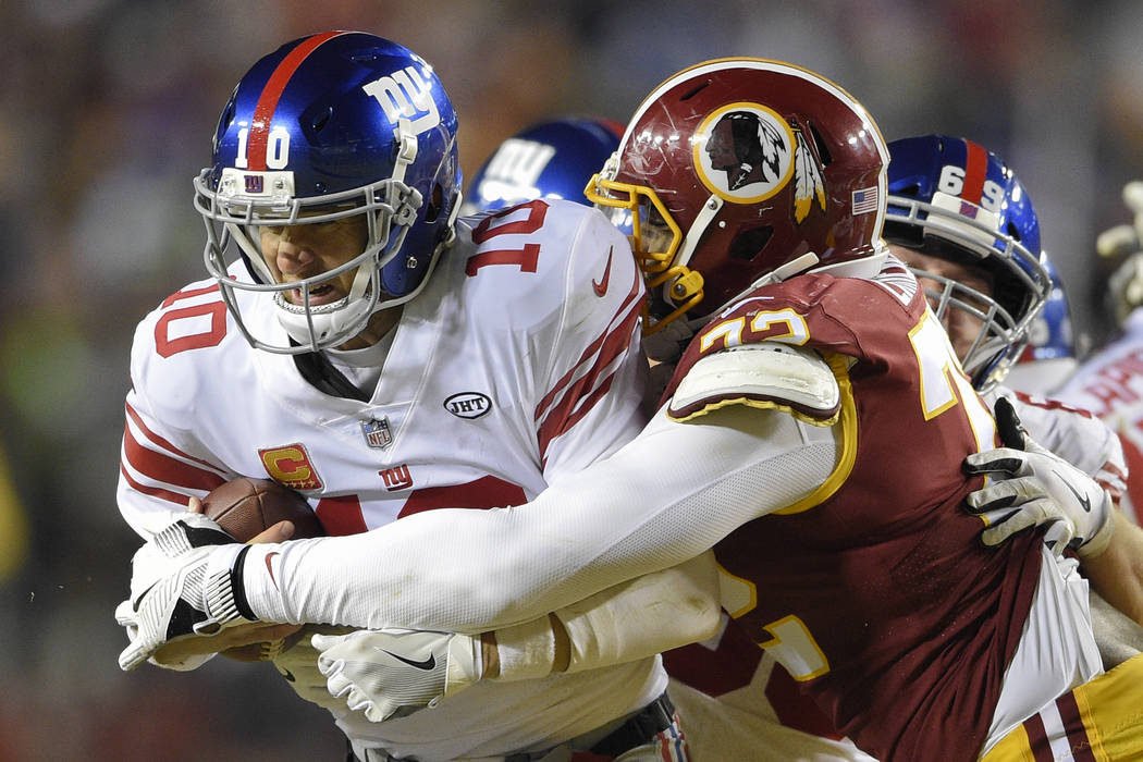 Washington Redskins offensive tackle Kevin Bowen (72) sacks New York Giants quarterback Eli Manning (10) during the second half of an NFL football game in Landover, Md., Thursday, Nov. 23, 2017. ( ...