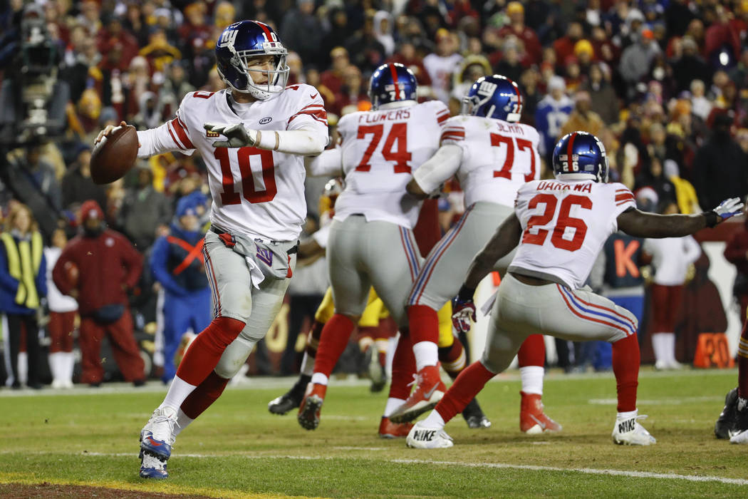 New York Giants quarterback Eli Manning (10) passes the ball during the second half of an NFL football game against the Washington Redskins in Landover, Md., Thursday, Nov. 23, 2017. (AP Photo/Pat ...
