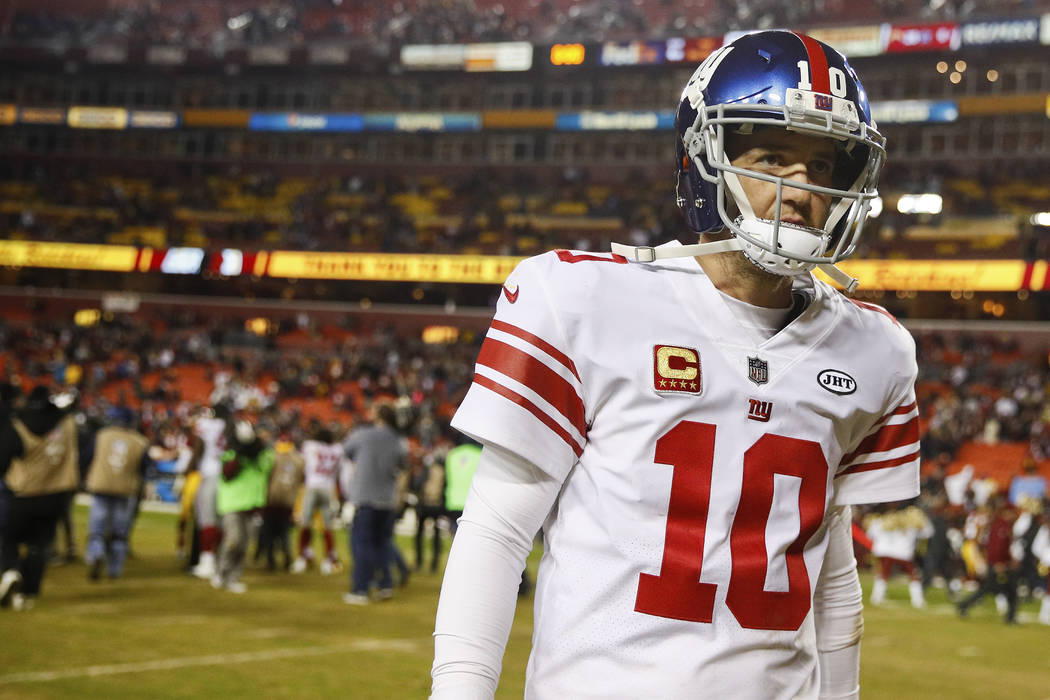 FILE - In this Nov. 23, 2017, file photo, New York Giants quarterback Eli Manning (10) walks off the field after a 2010 loss to the Washington Redskins, in an NFL football game in Landover, Md. Th ...