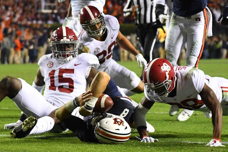 Nov 25, 2017; Auburn, AL, USA; Auburn Tigers quarterback Jarrett Stidham (8) scores a touchdown during the fourth quarter against the Alabama Crimson Tide at Jordan-Hare Stadium. Mandatory Credit: ...