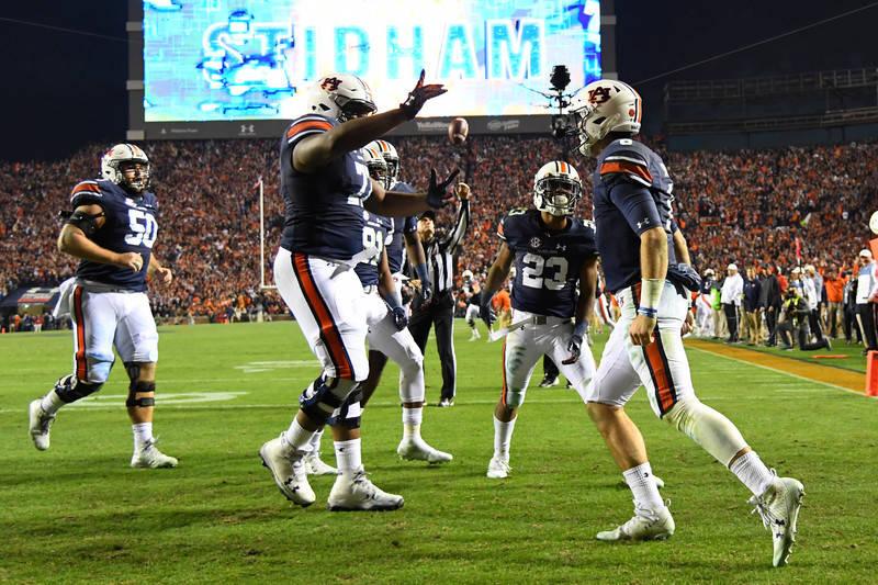 Nov 25, 2017; Auburn, AL, USA; Auburn Tigers quarterback Jarrett Stidham (8) celebrates his touchdown over the Alabama Crimson Tide during the fourth quarter at Jordan-Hare Stadium. Mandatory Cred ...