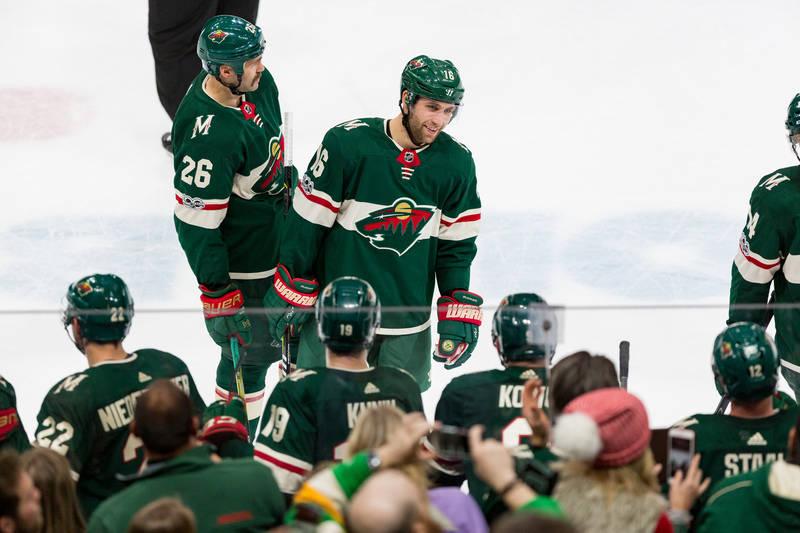 Nov 14, 2017; Saint Paul, MN, USA; Minnesota Wild Left Wing Jason Zucker (center) reacts after scoring a third period goal against the Philadelphia Flyers at Xcel Energy Center. Minnesota won 3-0. ...