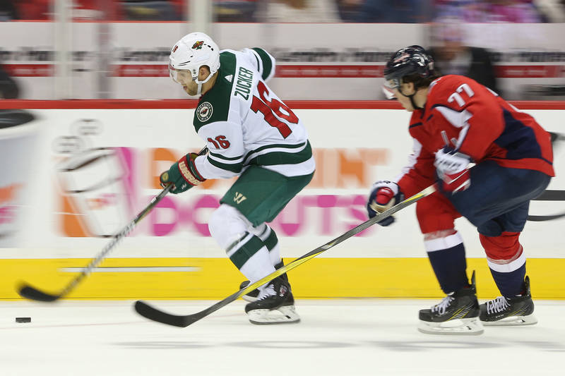 Nov 18, 2017; Washington, DC, USA; Minnesota Wild left wing Jason Zucker (16) skates with the puck as Washington Capitals right wing T.J. Oshie (77) chases in the third period at Capital One Arena ...