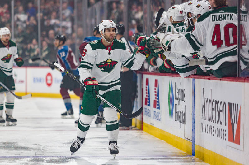 Nov 24, 2017; Saint Paul, MN, USA; Minnesota Wild Left Wing Jason Zucker (16) celebrates with teammates after his first period goal against the Colorado Avalanche at Xcel Energy Center. Mandatory  ...