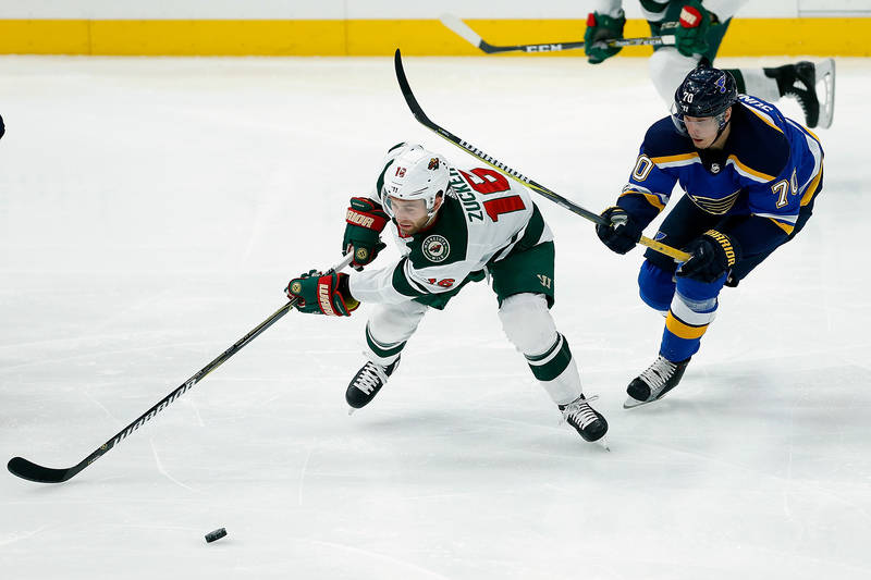 Nov 25, 2017; St. Louis, MO, USA; Minnesota Wild left wing Jason Zucker (16) and St. Louis Blues center Oskar Sundqvist (70) fight for control of the puck during the third period at Scottrade Cent ...